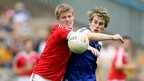 Tyrone's Frank Burns in action against Monaghan's Adam Treanor in the Ulster minor decider