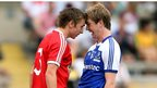 Ryhs Quinn and Fearghal McMahon lock horns during a dramatic Ulster MFC final at Clones