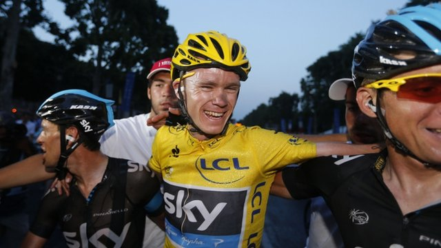 "Tour de France 2013 winner Britain""s Christopher Froome (C) celebrates with teammates on the Champs-Elysee avenue in Paris"
