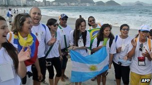 Young Catholics with an Argentine flag in Rio de Janeiro. Photo: 21 July 2013