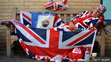 Royal supporter Terry Hutt poses for pictures on a bench where he has been camped out for 9 days outside the Lindo Wing