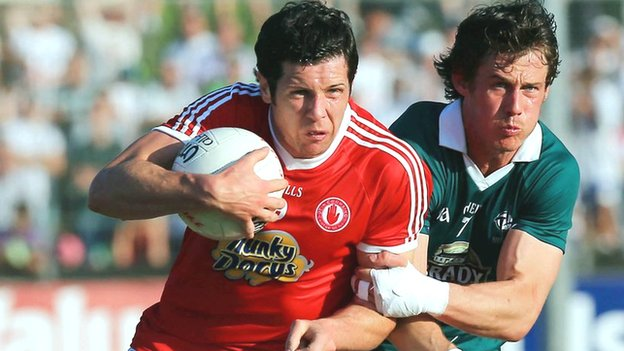 Tyrone's Sean Cavanagh holds off Emmet Bolton in the qualifier win over Kildare