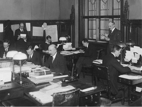 Civil servants at work in the House of Commons committee office in London