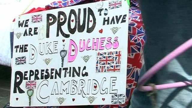 Some supporters have made signs for the royal couple