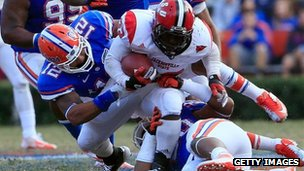 DaMarcus James is tackled by Antonio Morrison during the game at Ben Hill Griffin Stadium on 17 November 2012