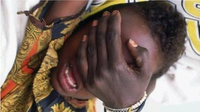A young girl being put through female circumcision