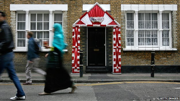 Brick-fronted building decorated for an Asian wedding. Image from http://www.bbc.co.uk/news/magazine-23407265