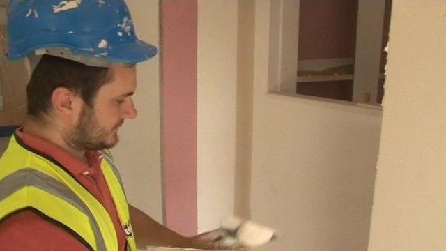 Plasterer finishing schools walls