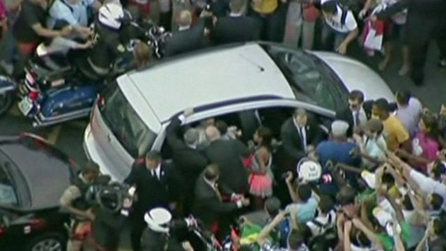 Pope Francis was mobbed as he was driven through Rio