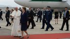Pope Francis (C) is welcomed by Brazilian President Dilma Rousseff (R) upon landing at Rio de Janeiro Airport
