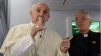 Pope Francis greets journalists on the papal flight to Rio de Janeiro on 22 July, 2013