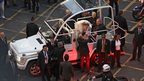 Pope Francis kisses a child on the Popemobile on his way to the Guanabara Palace after his arrival in Rio de Janeiro