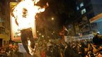 """Protesters burn an effigy of Rio de Janeiro""""s state Governor Sergio Cabral. Photo: 22 July 2013"""