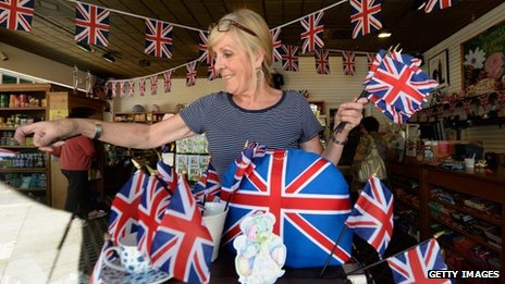 Linda Roberts dresses her windows with flags at Ye Olde King's Head English pub's gift shop in Santa Monica, California, to celebrate the royal baby's birth on 22 July 2013