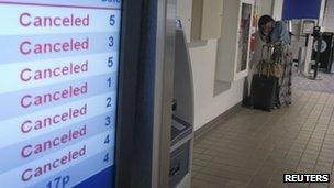 Departures board at LaGuardia airport (22 July 2013)