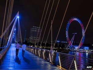 The Golden Jubilee bridges and the London Eye are illuminated in celebration of the birth of a baby boy for the Duke and Duchess of Cambridge on 22 July 2013