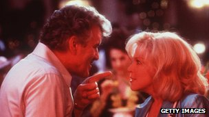 Dennis Farina with Bette Midler in 1997's That Old Feeling
