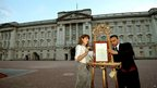 Official notice being placed in the forecourt of Buckingham Palace