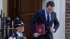 Royal press secretary Ed Perkins racing out of the hospital