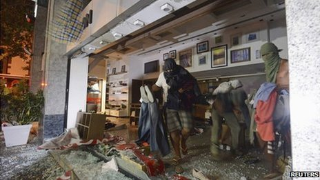 Masked men loot a store during a protest against Rio de Janeiro governor Sergio Cabral in Rio on 17 July 2013
