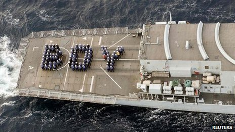 "The ship's company of the Royal Navy frigate HMS Lancaster forms the word ""BOY"" on the aft deck to mark the birth of Britain's new prince while on patrol in the Caribbean"