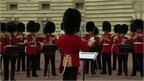 Palace guardsmen play 'Congratulations'