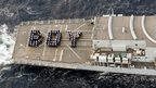 "HMS Lancaster's company spell out the word ""boy"" on the flight deck"