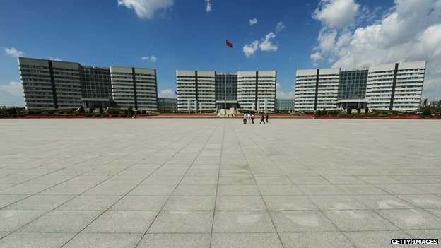 Government offices rise behind a large square in the city centre of Ordos, Inner Mongolia, China.