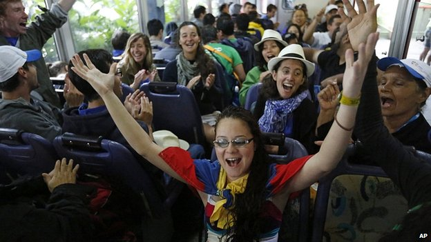 Youth from France, Venezuela and Canada in Brazil for World Youth Day ride a train to Corcovado mountain near Rio. 23 July 2013
