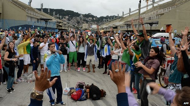 Pilgrims at Rio's Sambadrome before gathering at Copacabana Beach. 23 July 2013