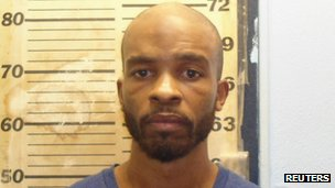 Michael Madison, 35, is pictured in this East Cleveland Police Department booking photo released on 23 July 2013