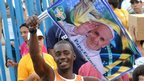 Man holds poster of Pope Francis in Rio.