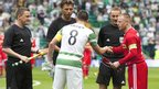 Celtic captain Scott Brown and Cliftonville counterpart George McMullan shake hands before the game at Celtic Park