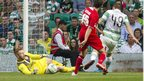 Cliftonville keeper Conor Devlin makes an early save as Celtic look to build on their 3-0 advantage from last week's first leg