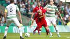 Cliftonville midfielder Barry Johnston moves clear of Celtic forward Anthony Stokes