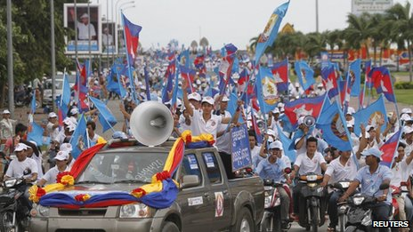 Supporters of the Cambodian People Party march along a street during an election rally in central Phnom Penh, 21 July 2013