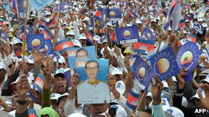 This photo taken on 19 July 2013 shows supporters of the Cambodia National Rescue Party (CNRP) holding portrait photos of Sam Rainsy at the Democracy Park in Phnom Penh