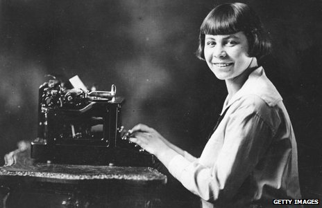 A 16-year-old Birdie Reeve, a champion typist capable of typing more than 200 words a minute, sitting at a typewriter in 1923