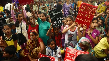 Indian children and activists shout anti-government slogans during a demonstration against the death of 23 children in Bihar state in New Delhi on July 20, 2013
