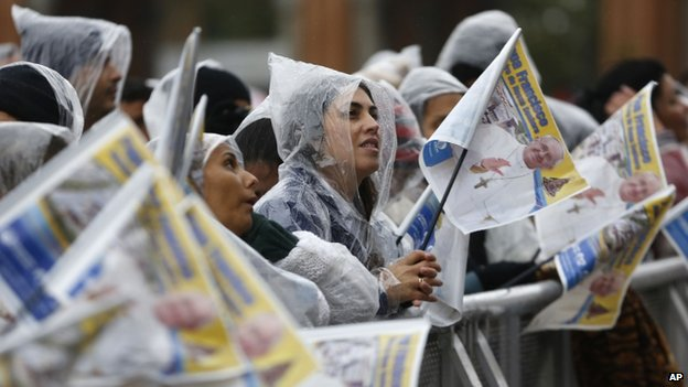 Pilgrims wait for the arrival of Pope Francis outside the Aparecida Basilica