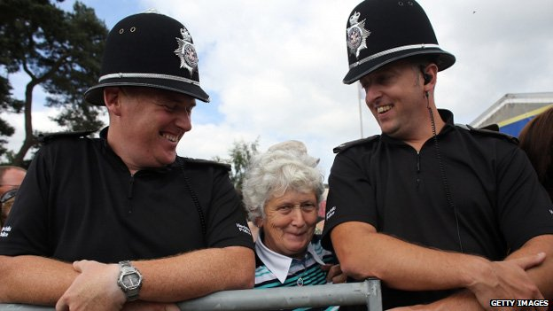 Police officers enjoying a joke with people waiting for the royal couple's arrival