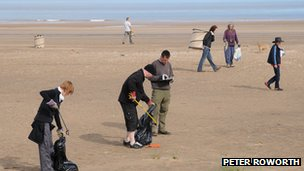Volunteers clear the beach at Crook Bank, Lincolnshire