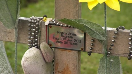 Decorations on a cross in Alfreton cemetery