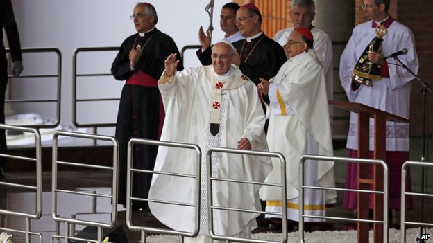 The Pope waves to crowds outside the Shrine of Our Lady of Aparecida