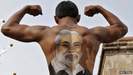 A supporter shows his back, with an image of Gujarat Chief Minister Narendra Modi, in Ahmedabad in this July 3, 2011 file photo