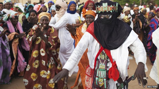 A Tuareg man dances at a campaign rally for presidential candidate Ibrahim Boubacar Keita in Timbuktu on 24 July 2013