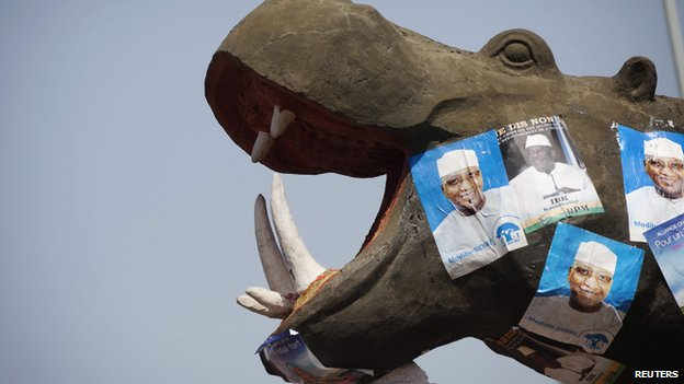 Electoral campaign posters are seen on a hippopotamus monument in Bamako, Mali - 23 July 2013