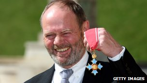 John Lloyd collecting his CBE