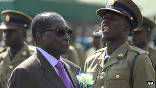 President Robert Mugabe inspects a guard of honour at a police passing-out parade in Harare, Zimbabwe on Thursday 13 June 2013