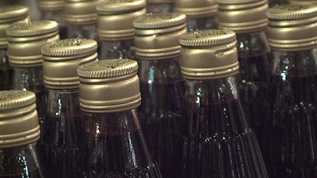 Vimto bottles on production line